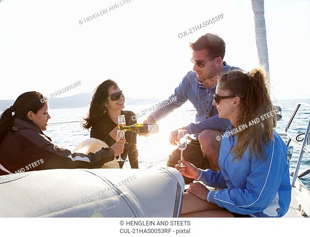 Friends with champagne on yacht