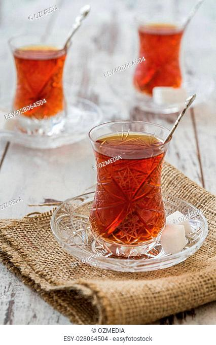 Turkish tea served in traditional glasses on white wooden background