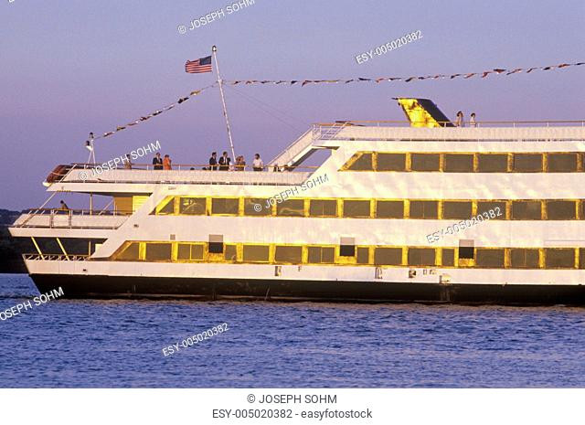 A large boat cruising down the Potomac River in Old Town Alexandria, Washington, D.C