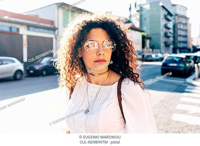 Woman in street in sunshine, Milan, Italy