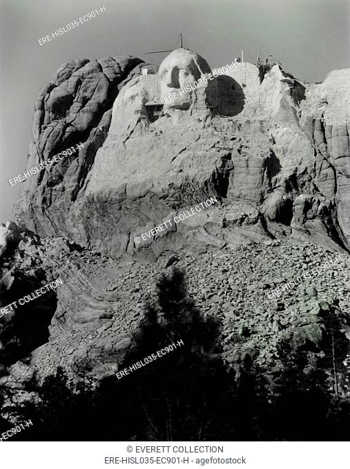 The first attempt at Thomas Jefferson on Mount Rushmore to the left of George Washington's head. It was blasted off due to poor rock quality and placed to the...