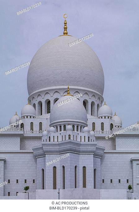 Ornate domed building under cloudy sky, Abu Dhabi, Abu Dhabi Emirate, United Arab Emirates