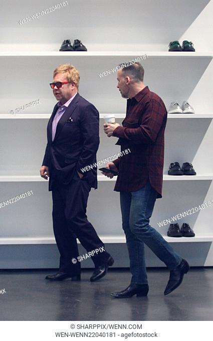 Sir Elton John spotted shoe shopping at Saint Laurent on Rodeo Drive with his husband David Furnish Featuring: Sir Elton John, David Furnish Where: Los Angeles