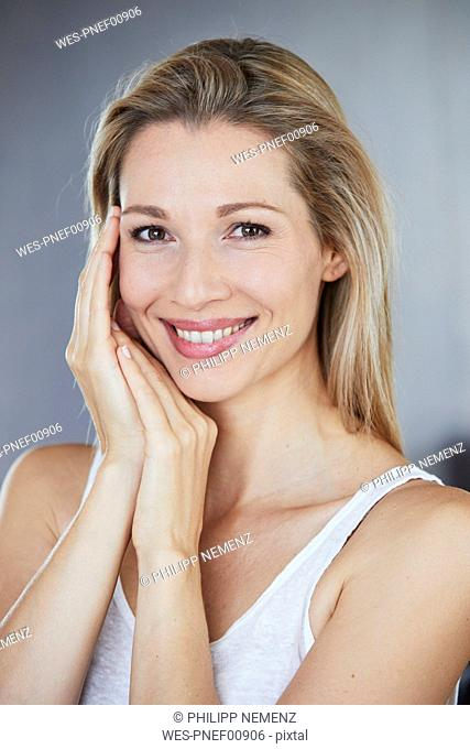 Portrait of smiling blond woman in the morning
