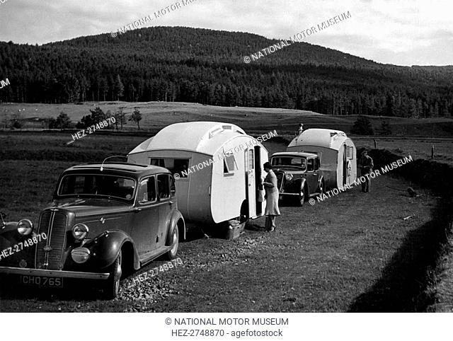 1937 Hillman 14 towing caravan. Creator: Unknown