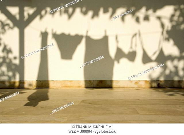 Silhouette of clothes on clothesline
