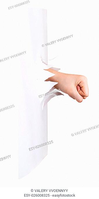 side view of the fist breaks a paper wall isolated on white background