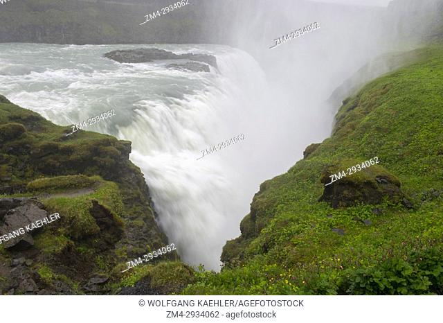 Detail of the Gullfoss (Golden Falls) waterfall in the rain located in the canyon of the Hvita River in southwest Iceland, part of the golden circle road trip