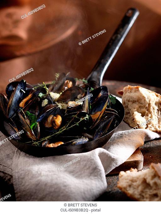 Mussels mariniere in saucepan