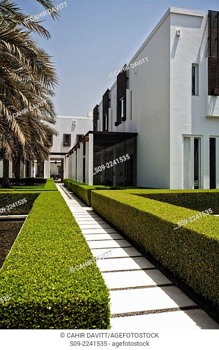 Walkway and topiary leading to the hotel lobby in the grounds of the 5 star Chedi Hotel, in Ghubrah, Muscat, Masqat, Oman