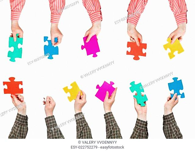 male hands in shirt sleeves with puzzle pieces