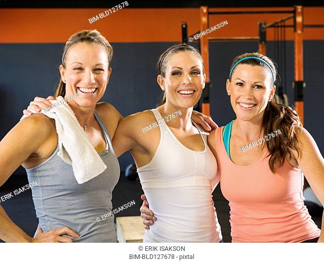 Women smiling together in gym