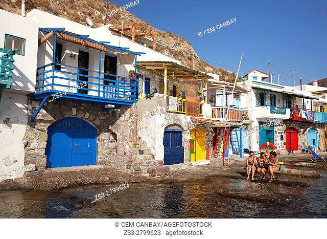Tourists in front of the fisherman houses with boat shelters in Klima village, Milos, Cyclades Islands, Greek Islands, Greece, Europe