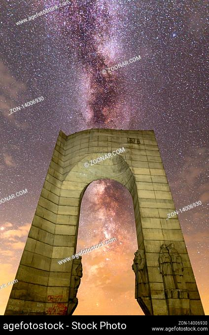 Troyan, Bulgaria - 16 August 2018: A view of The Arch of Freedom monument with the Milky Way in the foreground. Night sky nature summer landscape