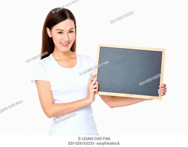 Young Woman show with the blank screen of chalkboard
