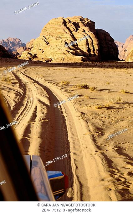 A car crossing the Wadi Rum desert, Jordan, Middle East