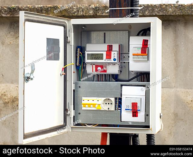 Introductory machine and electric energy meter in a dashboard on a pole on a land plot