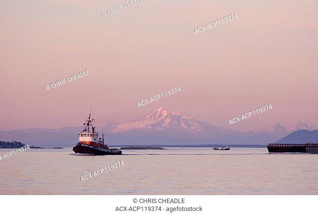 Tugboat towing barge off Sidney, British Columbia, Canada