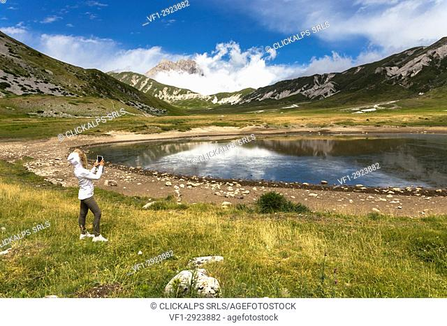 The Corno Grande reflected in Pietranzoni lake, Campo Imperatore, l'Aquila district, Abruzzo, Italy