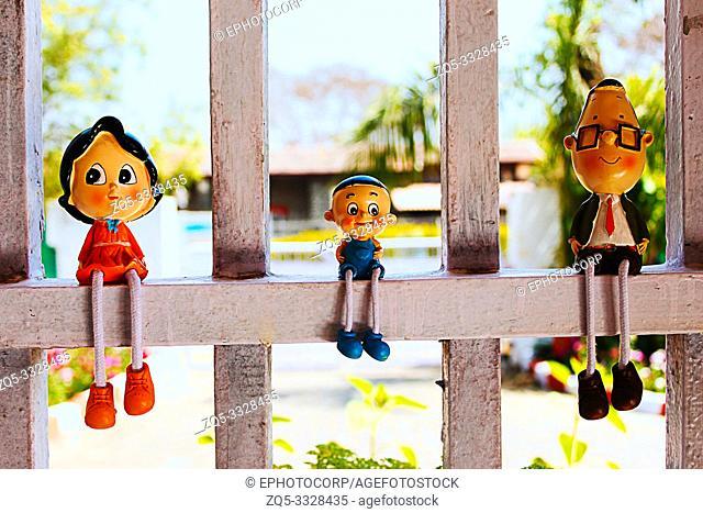 Toy miniatures on window