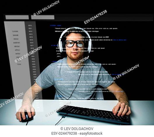 technology, cyberspace, virtual reality and people concept - man or hacker in headset and eyeglasses with keyboard hacking computer system or programming over...