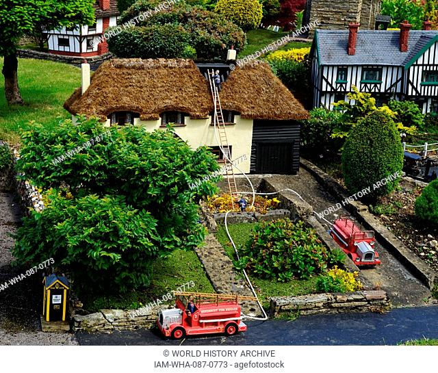 Fire engines at a fire, depicted in the model village at Bekonscot in Beaconsfield, Buckinghamshire, England, is the oldest original model village in the world