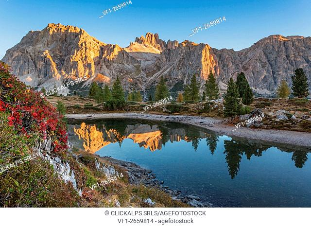 Europe, taly, Veneto, Belluno. Lake Limedes with the colors of autumn. In the background Lagazuoi and Fanis illuminated by the rays of the morning sun