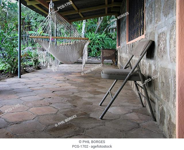 Guest house in a village in the Tarahamara area. Traditional mountain village house. Terrace. Chairs. Hammock