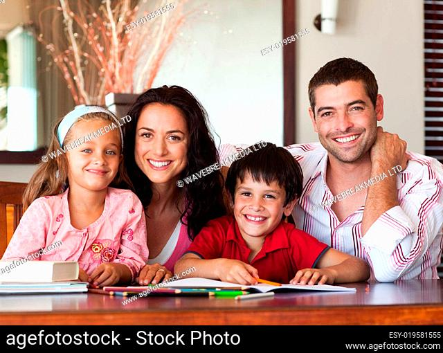 Nice parents helping their children for homework