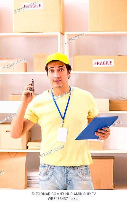 Handsome contractor working in box delivery relocation service