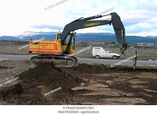 digger digging cunstruction trench