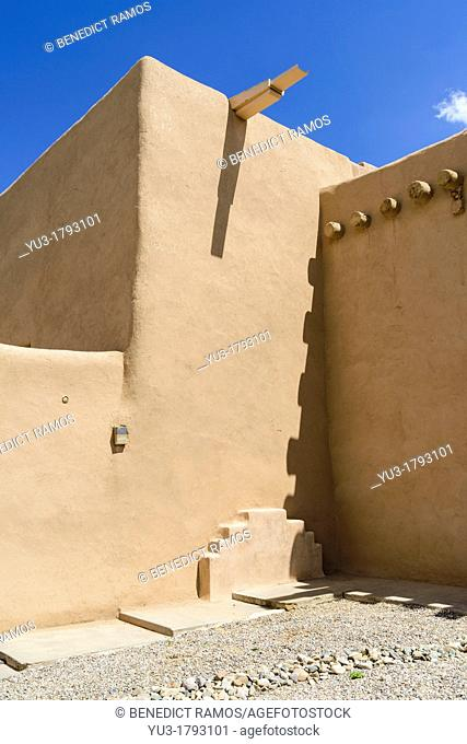 Detail of mission church built in the adobe or Indian pueblo style, Ranchos de Taos, New Mexico, USA