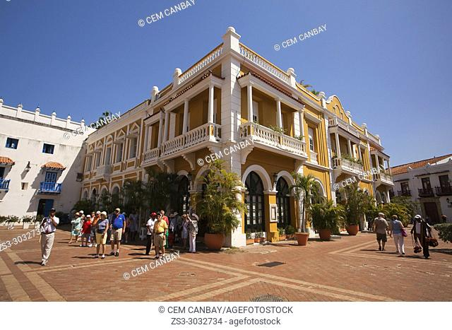 View to the tourists and colonial buildings at the historic center in Plaza de San Pedro Claver Square, Cartagena de Indias, Bolivar, Colombia, South America