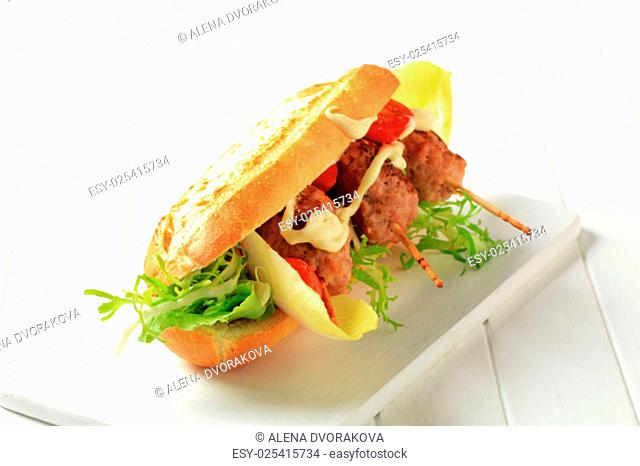 Crispy French bread with meatballs on sticks