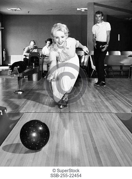 Front view of a family bowling