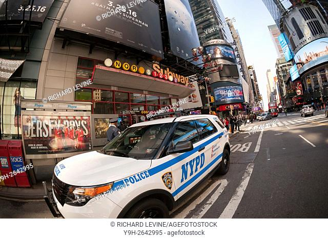 An NYPD vehicle in New York parked in front of subway entrance in Times Square