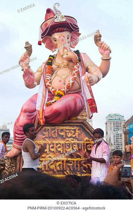 People at religious procession during Ganpati visarjan ceremony, Mumbai, Maharashtra, India