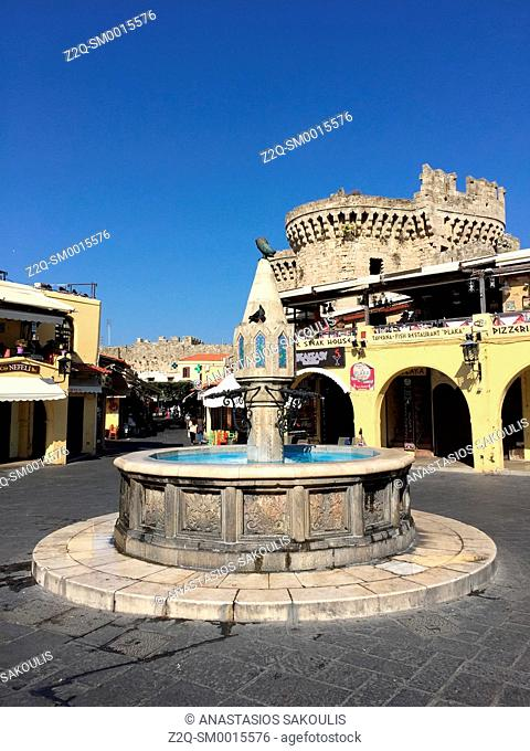 Ippokratous Square, the Old Town World Heritage City, UNESCO. At background The Citadel of Rhodes, the Dodecanese, Greece