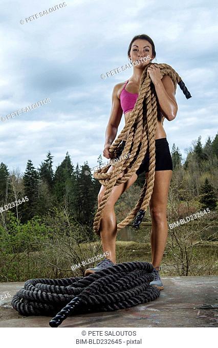 Mixed Race posing with heavy ropes