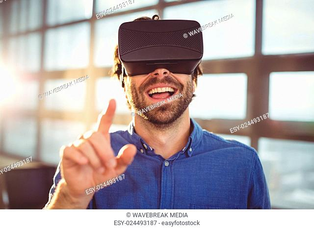 Male business executive using virtual reality headset
