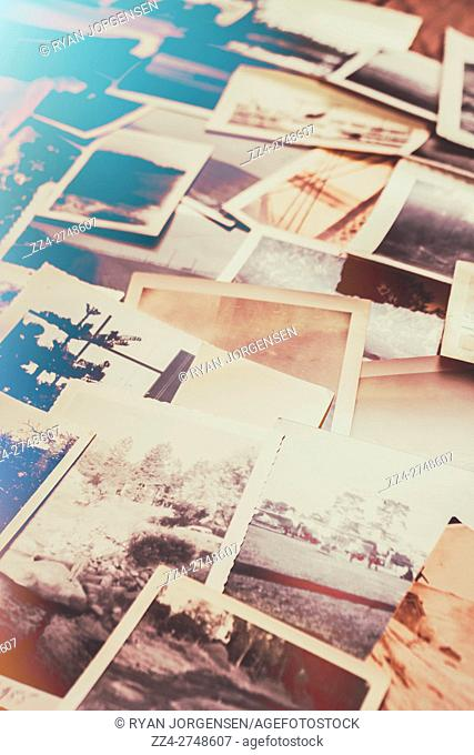 Retro flare photo album design on a scattered collage of old film photography. Past places