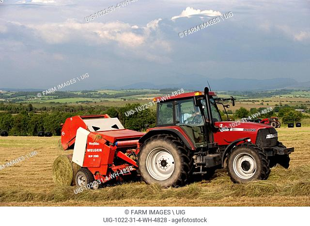 Big baling silage with a CASE tractor as a storm builds up. Cumbria. (Photo by: Wayne Hutchinson/Farm Images/UIG)