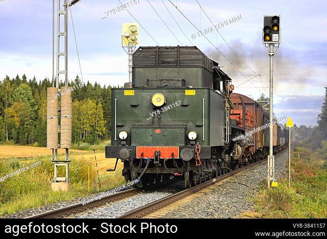 Hr1 class steam locomotive Ukko-Pekka 1009 pulling carriages between Urjala and Humppila, Finland. September 18, 2020