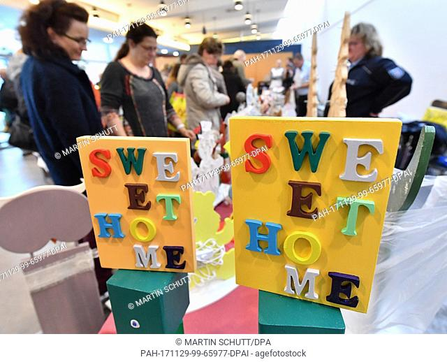 Christmas decorations from workshop at the Suhl prison are sold at the traditional Christmas bazaar of the prisons in Thuringia in Erfurt, Germany