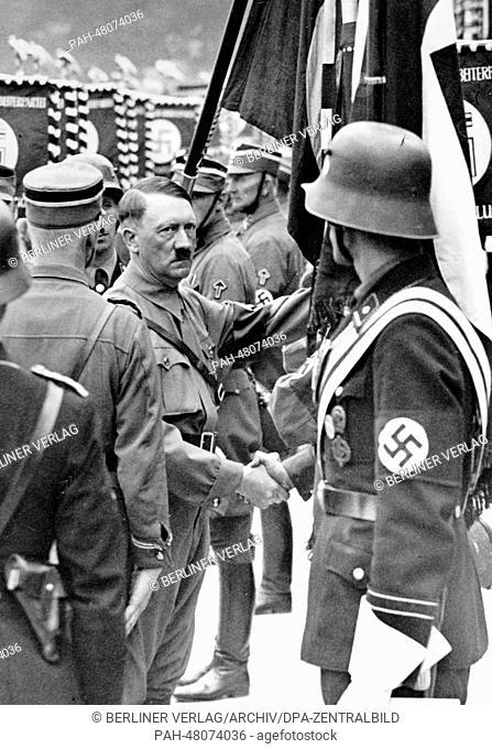 Nuremberg Rally 1937 in Nuremberg, Germany - Adolf Hitler consecrates the new standards of SA (Sturmabteilung), SS (Schutzstaffel) and NSKK (National Socialist...