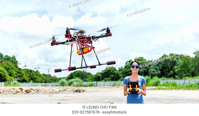 Young Woman fly with drone