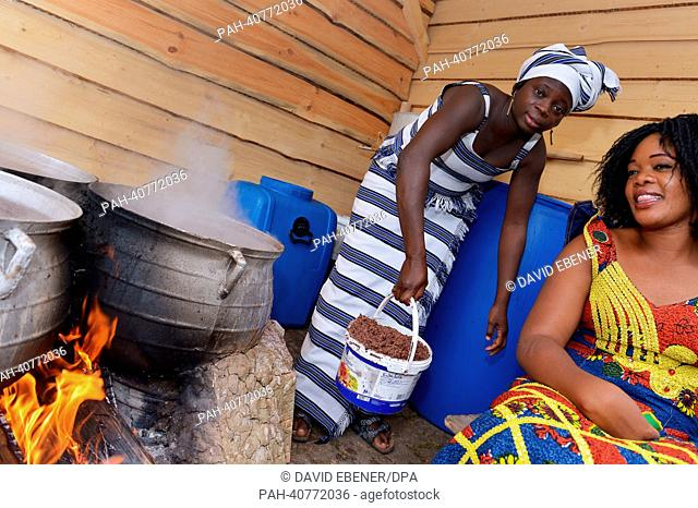 Master brewer from Burkina Faso, Ine Kam (L), brews her millet beer at the brewery of Weissenohe Abbey in Weissenohe, Germany, 03 July 2013