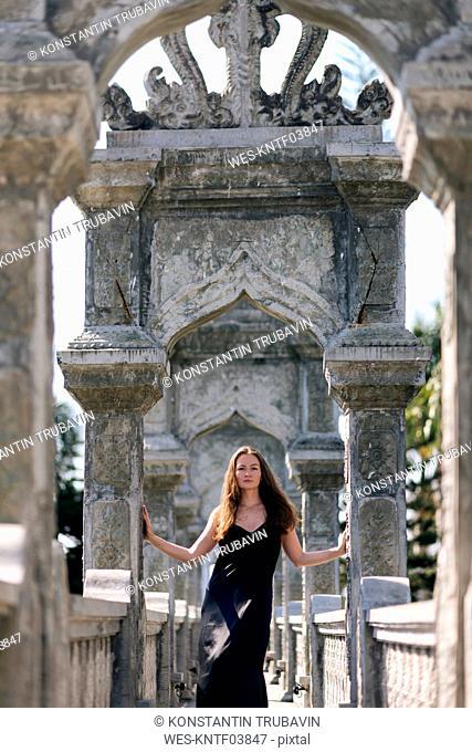 Young woman in Ujung Water Palace, Karangasem, Bali, Indonesia