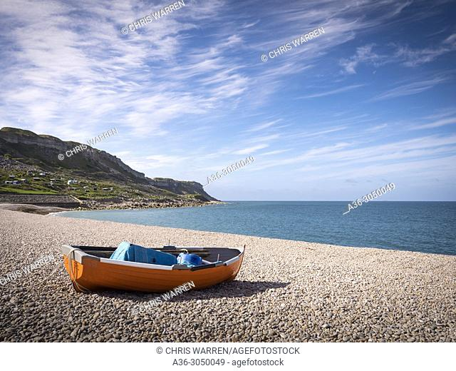 Rowing boat on the beach Chesil Beach Portland Dorset England