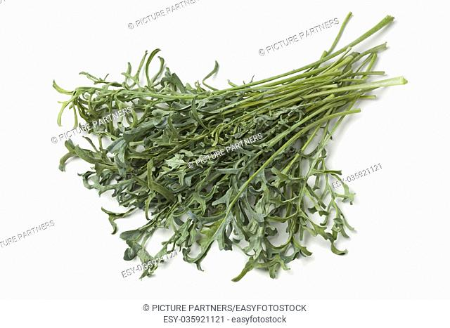 Heap of fresh homegrown Jagallo Nero Kale on white background
